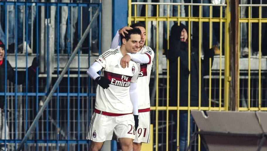AC Milan's Italian midfielder Giacomo Bonaventura (C) celebrates with teammate Italian midfielder Andrea Bertolacci after scoring a goal during the Italian Serie A football match between Empoli and AC Milan, on January 23, 2016 at the Carlo Castellani stadium in Empoli.  / AFP / ANDREAS SOLARO        (Photo credit should read ANDREAS SOLARO/AFP/Getty Images)