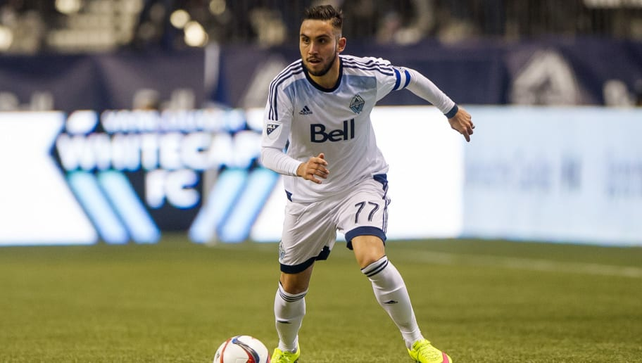 VANCOUVER, BC - MARCH 28: Pedro Morales #77 of the Vancouver Whitecaps FC runs with the ball in MLS action against the Portland Timbers on March 28, 2015 at BC Place Stadium in Vancouver, British Columbia, Canada.  (Photo by Rich Lam/Getty Images)