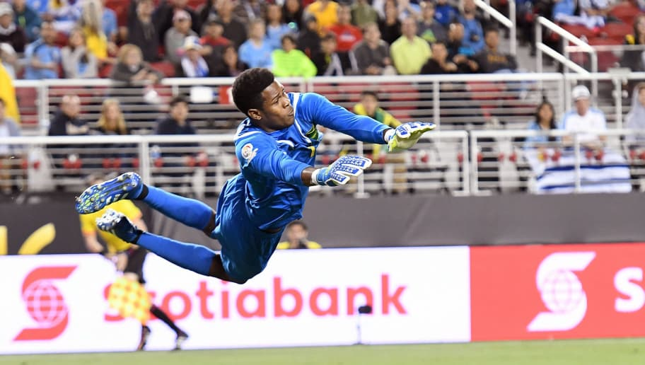 SANTA CLARA, CA - JUNE 13:  Goal keeper Andre Blake #1 of Jamaica dives to make a save against Uruguay during the 2016 Copa America Centenario Group match play between Uruguay and Jamaica at Levi's Stadium on June 13, 2016 in Santa Clara, California.  (Photo by Thearon W. Henderson/Getty Images)