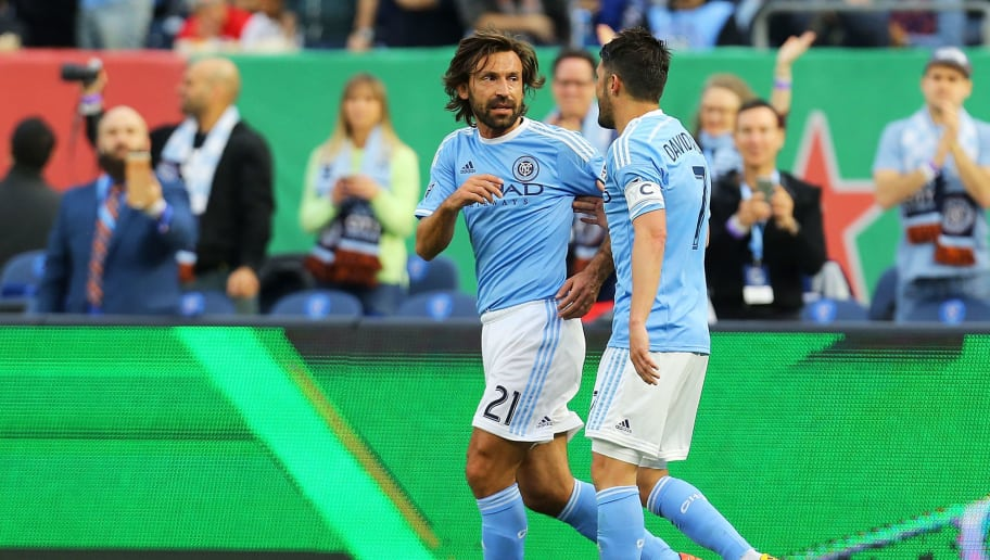 NEW YORK, NY - MARCH 13: David Villa #7 of New York City FC celebrates his first half goal with teamate Andrea Pirlo #21 againd the Toronto FC at Yankee Stadium on March 13, 2016 in the Bronx borough of New York City. (Photo by Mike Stobe/Getty Images)