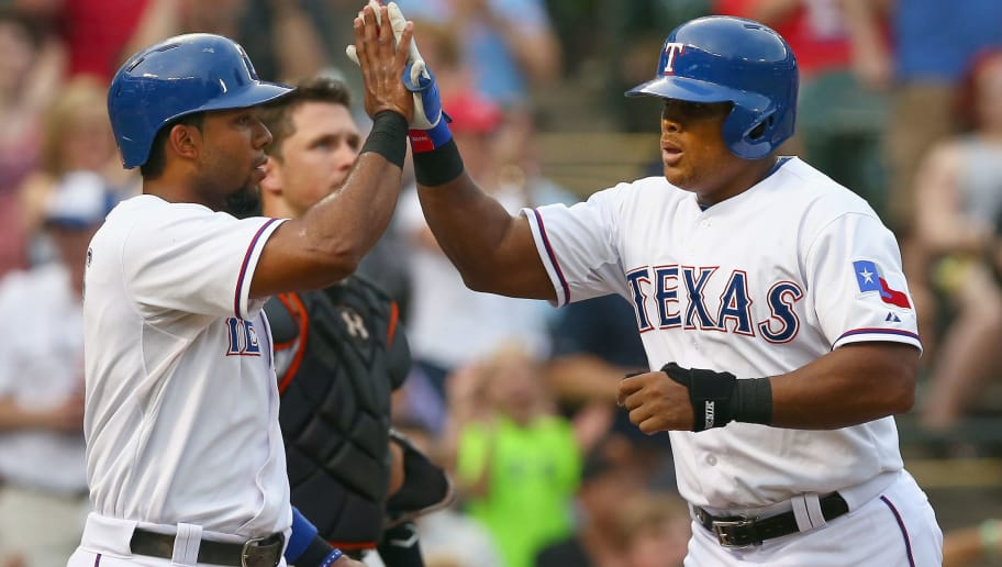 ARLINGTON, TX - JULY 31:  Adrian Beltre #29 of the Texas Rangers and Elvis Andrus #1 of the Texas Rangers celebrate after Beltre hit a two run home run against the San Francisco Giants in the bottom of the first inning at Globe Life Park in Arlington on July 31, 2015 in Arlington, Texas.  (Photo by Tom Pennington/Getty Images)