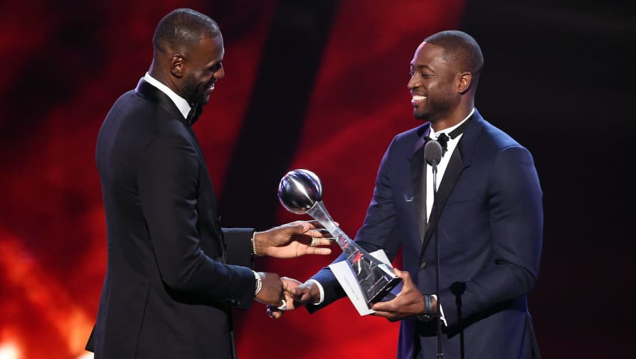 LOS ANGELES, CA - JULY 13:  NBA player LeBron James (L) accepts the Best Male Athlete award from NBA player Dwyane Wade onstage during the 2016 ESPYS at Microsoft Theater on July 13, 2016 in Los Angeles, California.  (Photo by Kevin Winter/Getty Images)