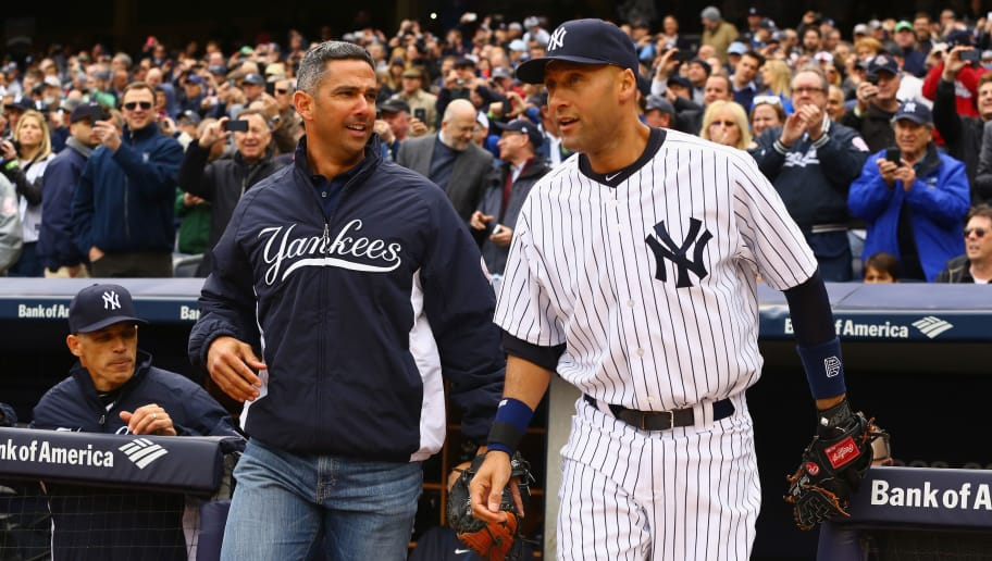 NEW YORK, NY - APRIL 07:  Former New York Yankee Jorge Posada and Derek Jeter #2 of the New York Yankees are introduced before their home opener against the Baltimore Orioles on April 7, 2014 at Yankee Stadium in the Bronx borough of New York City.  (Photo by Al Bello/Getty Images)
