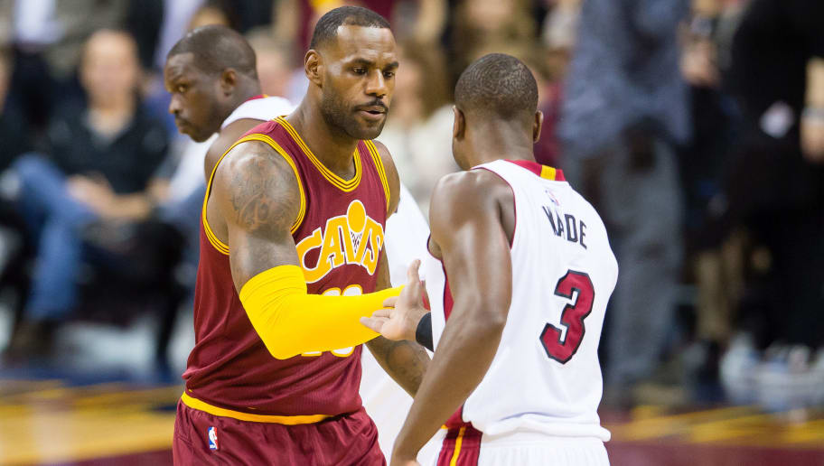 CLEVELAND, OH - OCTOBER 30: LeBron James #23 of the Cleveland Cavaliers and Dwyane Wade #3 of the Miami Heat shake hands during the first half at Quicken Loans Arena on October 30, 2015 in Cleveland, Ohio. NOTE TO USER: User expressly acknowledges and agrees that, by downloading and or using this photograph, User is consenting to the terms and conditions of the Getty Images License Agreement. (Photo by Jason Miller/Getty Images)