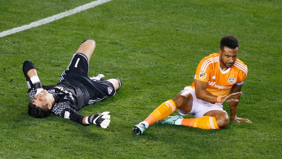 HOUSTON, TX - MARCH 12:  Jesse Gonzalez #1 of FC Dallas and Giles Barnes #10 of the Houston Dynamo wait on the pitch after colliding during their game at BBVA Compass Stadium on March 12, 2016 in Houston, Texas.  (Photo by Scott Halleran/Getty Images)