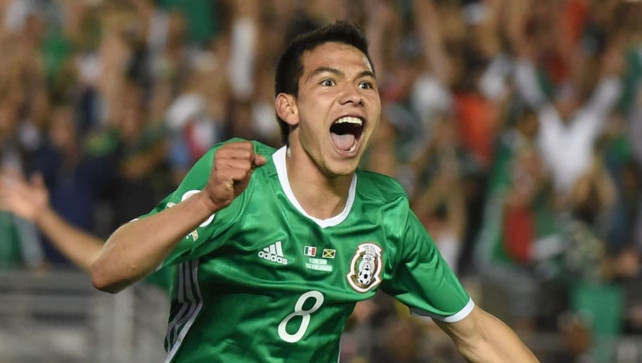 Mexico's Oribe Peralta (R) celebrates with teammate Hirving Lozano after scoring against Jamaica during their Copa America Centenario football tournament match in Pasadena, California, United States, on June 9, 2016. / AFP / Mark Ralston        (Photo credit should read MARK RALSTON/AFP/Getty Images)