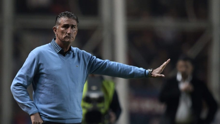 Argentina's San Lorenzo coach Edgardo Bauza gestures during the Copa Libertadores 2015 group 2 football match against Uruguay's Danubio at Pedro Bidegain stadium in Buenos Aires, Argentina, on April 22, 2015. AFP PHOTO / JUAN MABROMATA        (Photo credit should read JUAN MABROMATA/AFP/Getty Images)