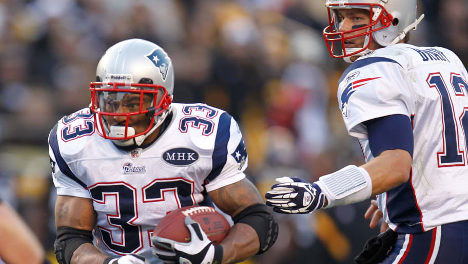 PITTSBURGH, PA - OCTOBER 30:  Tom Brady #12 of the New England Patriots hands offsides to Kevin Faulk #33 against the Pittsburgh Steelers at Heinz Field on October 30, 2011 in Pittsburgh, Pennsylvania.  (Photo by Gregory Shamus/Getty Images)