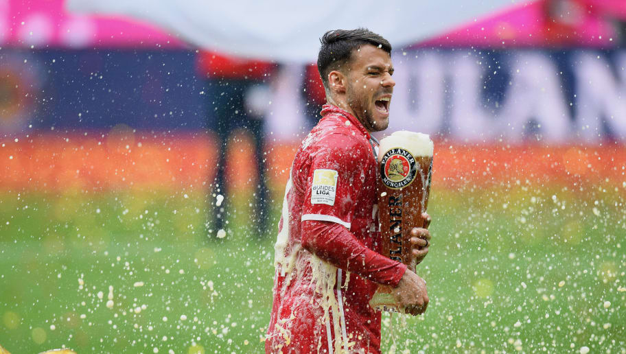 MUNICH, GERMANY - MAY 14: Juan Bernat of Muenchen gets beer thrown over him in celebration following the Bundesliga match between FC Bayern Muenchen and Hannover 96 at Allianz Arena on May 14, 2016 in Munich, Germany.  (Photo by Matthias Hangst/Bongarts/Getty Images)