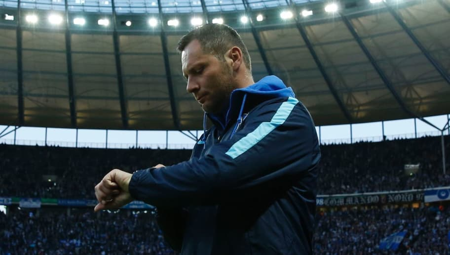 Hertha's Hungarian head coach Pal Dardai checks his watch prior to the German Cup (DFB Pokal) semi-final football match Hertha Berlin v Borussia Dortmund at the Olympic stadium in Berlin on April 20, 2016.    / AFP / ODD ANDERSEN / RESTRICTIONS: ACCORDING TO DFB RULES IMAGE SEQUENCES TO SIMULATE VIDEO IS NOT ALLOWED DURING MATCH TIME. MOBILE (MMS) USE IS NOT ALLOWED DURING AND FOR FURTHER TWO HOURS AFTER THE MATCH. == RESTRICTED TO EDITORIAL USE == FOR MORE INFORMATION CONTACT DFB DIRECTLY AT +49 69 67880   /         (Photo credit should read ODD ANDERSEN/AFP/Getty Images)