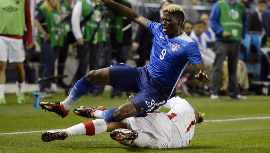 CARSON, CA - FEBRUARY 5: Gyasi Zardes #9 of the United States is tackled by Marcel De Jong #17 of Canada during the first half of their international friendly soccer match at StubHub Center February 5, 2016, in Carson, California. (Photo by Kevork Djansezian/Getty Images)