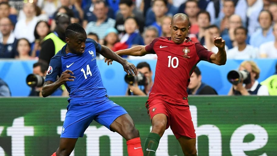 France's midfielder Blaise Matuidi (L) vies for the ball against Portugal's midfielder Joao Mario during the Euro 2016 final football match between France and Portugal at the Stade de France in Saint-Denis, north of Paris, on July 10, 2016. / AFP / FRANCK FIFE        (Photo credit should read FRANCK FIFE/AFP/Getty Images)