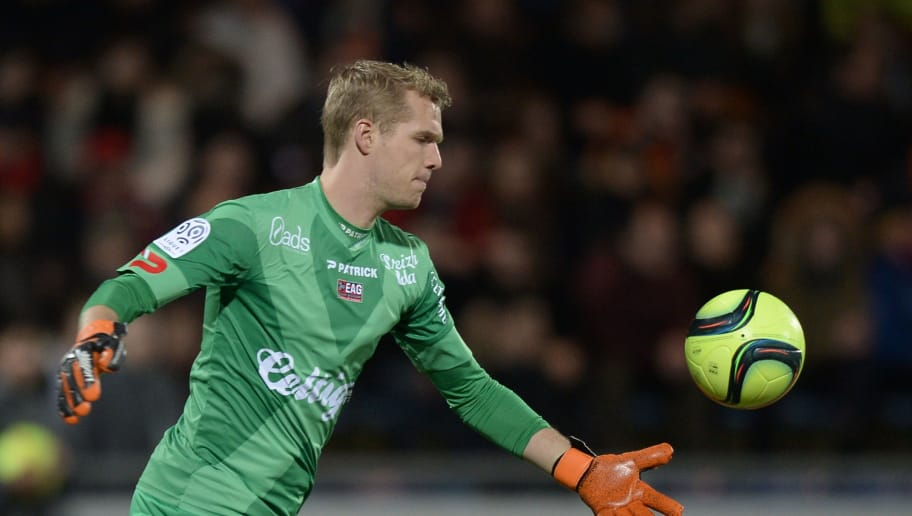 Guingamp's Danish goalkeeper Jonas Lossl throws the ball during the French L1 football match between Lorient and Guingamp at Moustoir Stadium in Lorient, western France, on February 20, 2016. AFP PHOTO / JEAN-SEBASTIEN EVRARD / AFP / JEAN-SEBASTIEN EVRARD        (Photo credit should read JEAN-SEBASTIEN EVRARD/AFP/Getty Images)