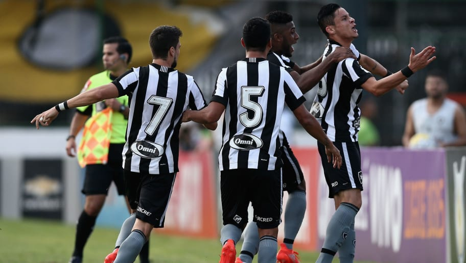 RIO DE JANEIRO, BRAZIL - JULY 16: Players of Botafogo celebrate a scored goal against Flamengo during a match between Flamengo and Botafogo as part of Brasileirao Series A 2016 at Luso Brasileiro Stadium on July 16, 2016 in Rio de Janeiro, Brazil. (Photo by Buda Mendes/Getty Images)