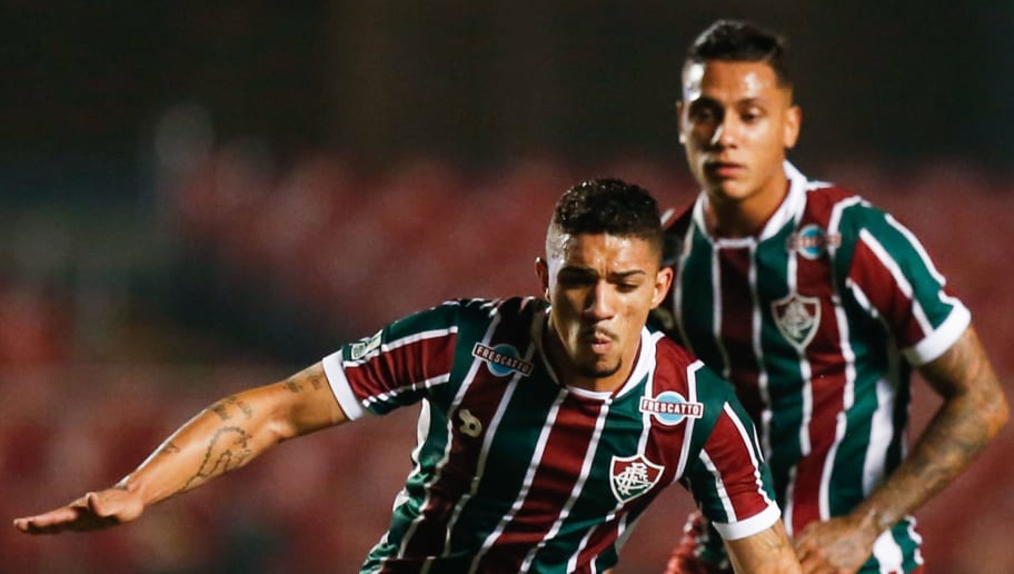 SAO PAULO, BRAZIL - JUNE 29:  Douglas (L) of Fluminense and Centurion of Sao Paulo in action during the match between Sao Paulo and Fluminense for the Brazilian Series A 2016 at Morumbi stadium on June 29, 2016 in Sao Paulo, Brazil. (Photo by Alexandre Schneider/Getty Images)