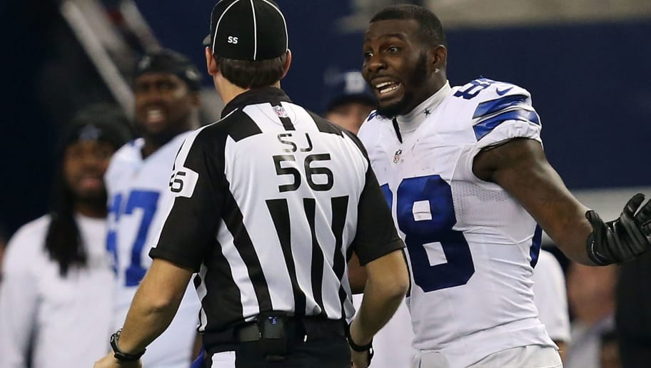 ARLINGTON, TX - JANUARY 04:  Dez Bryant #88 of the Dallas Cowboys argues with side judge Allen Baynes #56 after a penatly was called against Anthony Hitchens #59 of the Dallas Cowboys when he collided with Brandon Pettigrew #87 of the Detroit Lions on a pass play during the second half of their NFC Wild Card Playoff game at AT&T Stadium on January 4, 2015 in Arlington, Texas.  (Photo by Sarah Glenn/Getty Images)