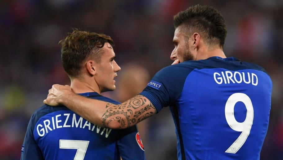 TOPSHOT - France's forward Olivier Giroud (R) celebrates with France's forward Antoine Griezmann after he scored a penalty shot giving France the first goal of the match during the Euro 2016 semi-final football match between Germany and France at the Stade Velodrome in Marseille on July 7, 2016.  / AFP / PATRIK STOLLARZ        (Photo credit should read PATRIK STOLLARZ/AFP/Getty Images)