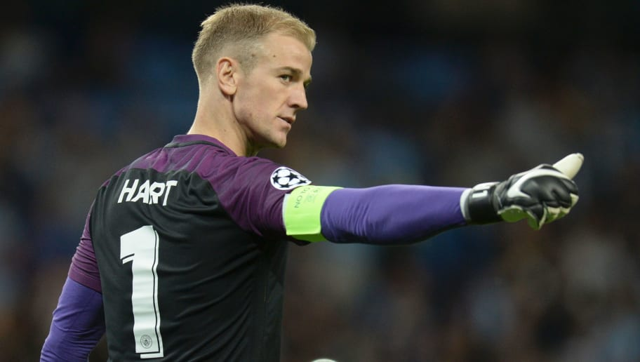 Manchester City's English goalkeeper Joe Hart gestures to members of the crowd as he comes out for the second half during the UEFA Champions league second leg play-off football match between Manchester City and Steaua Bucharest at the Etihad Stadium in Manchester, north west England on August 24, 2016. / AFP / OLI SCARFF        (Photo credit should read OLI SCARFF/AFP/Getty Images)