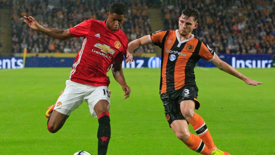 Manchester United's English striker Marcus Rashford vies with Hull City's Scottish defender Andrew Robertson (R) during the English Premier League football match between Hull City and Manchester United at the KCOM Stadium in Kingston upon Hull, north east England on August 27, 2016. Manchester united won the game 1-0. / AFP / Lindsey PARNABY / RESTRICTED TO EDITORIAL USE. No use with unauthorized audio, video, data, fixture lists, club/league logos or 'live' services. Online in-match use limited to 75 images, no video emulation. No use in betting, games or single club/league/player publications.  /         (Photo credit should read LINDSEY PARNABY/AFP/Getty Images)