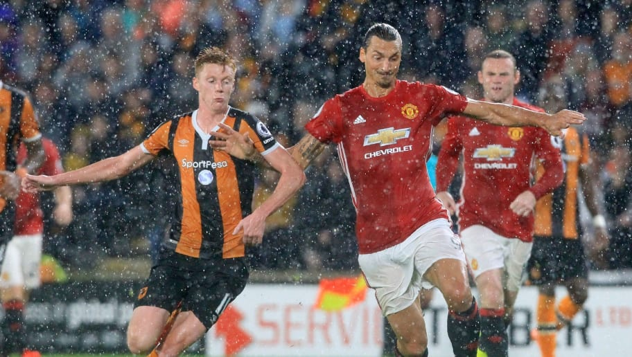 Hull City's English midfielder Sam Clucas (L) vies with Manchester United's Swedish striker Zlatan Ibrahimovic during the English Premier League football match between Hull City and Manchester United at the KCOM Stadium in Kingston upon Hull, north east England on August 27, 2016. Manchester united won the game 1-0. / AFP / Lindsey PARNABY / RESTRICTED TO EDITORIAL USE. No use with unauthorized audio, video, data, fixture lists, club/league logos or 'live' services. Online in-match use limited to 75 images, no video emulation. No use in betting, games or single club/league/player publications.  /         (Photo credit should read LINDSEY PARNABY/AFP/Getty Images)