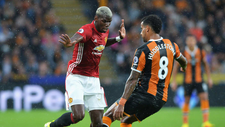 HULL, ENGLAND - AUGUST 27: Paul Pogba of Manchester United takes on Tom Huddlestone of Hull City during the Premier League match between Hull City and Manchester United at KCOM Stadium on August 27, 2016 in Hull, England.  (Photo by Mark Runnacles/Getty Images)
