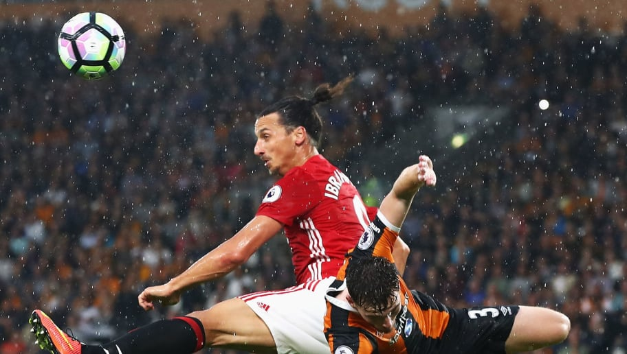 HULL, ENGLAND - AUGUST 27: Zlatan Ibrahimovic of Manchester United (L) climbs above Andrew Robertson of Hull City (R) to head the ball during the Premier League match between Hull City and Manchester United at KCOM Stadium on August 27, 2016 in Hull, England.  (Photo by Matthew Lewis/Getty Images)