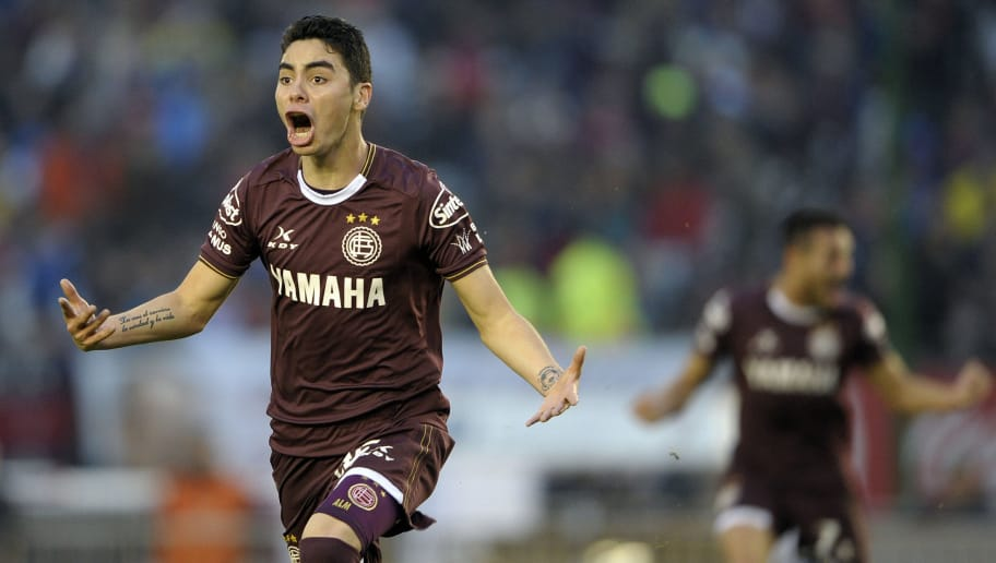 Lanus' midfielder Miguel Almiron celebrates after scoring the team's second goal against San Lorenzo during an Argentina First Divison football final match at the Momnumental stadium in Buenos Aires, Argentina, on May 29, 2016.  / AFP / ALEJANDRO PAGNI        (Photo credit should read ALEJANDRO PAGNI/AFP/Getty Images)