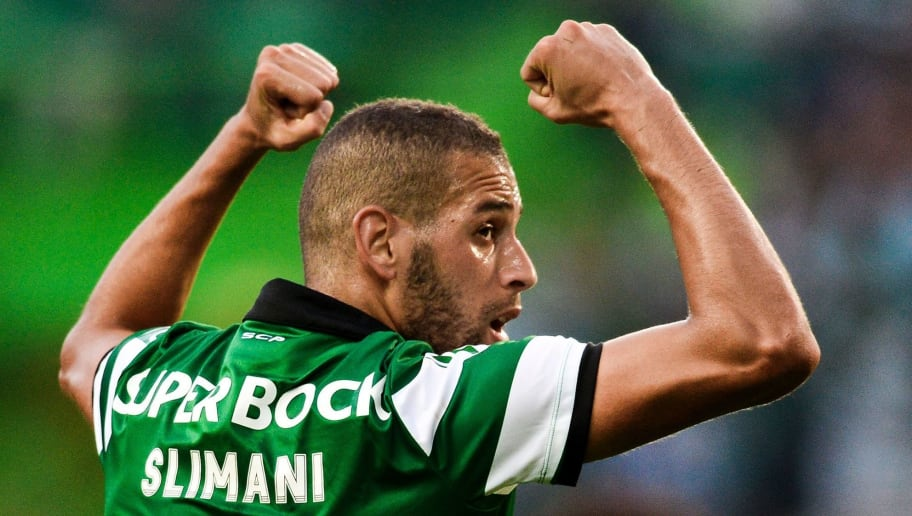 Sporting's Algerian forward Islam Slimani celebrates after scoring against VFL Wolfsburg during the Violinos Cup football match between Sporting CP and VFL Wolfsburg at Alvalade stadium in Lisbon on July 30, 2016.  / AFP / PATRICIA DE MELO MOREIRA        (Photo credit should read PATRICIA DE MELO MOREIRA/AFP/Getty Images)