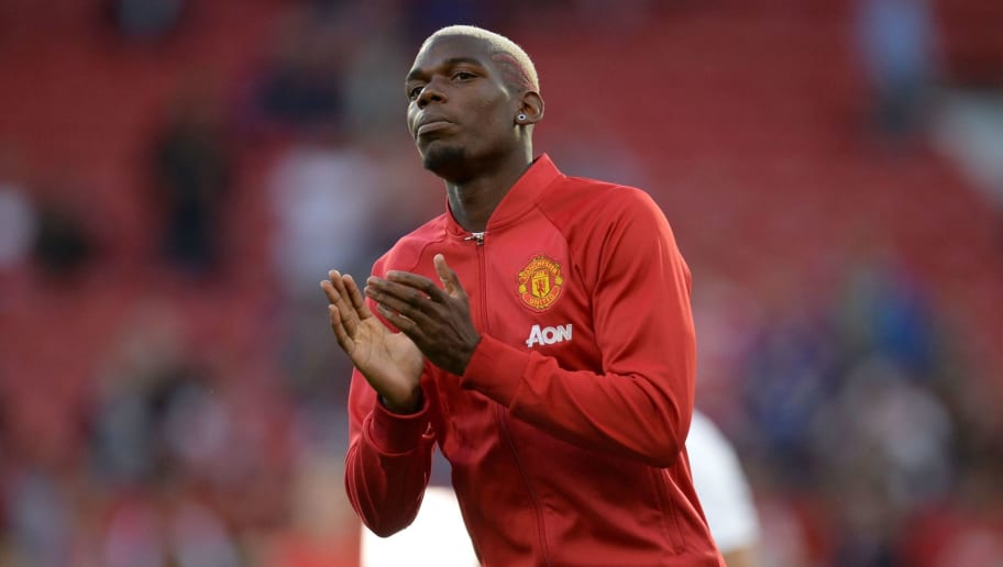 Manchester United's French midfielder Paul Pogba warms up ahead of the English Premier League football match between Manchester United and Southampton at Old Trafford in Manchester, north west England, on August 19, 2016. / AFP / Oli SCARFF / RESTRICTED TO EDITORIAL USE. No use with unauthorized audio, video, data, fixture lists, club/league logos or 'live' services. Online in-match use limited to 75 images, no video emulation. No use in betting, games or single club/league/player publications.  /         (Photo credit should read OLI SCARFF/AFP/Getty Images)