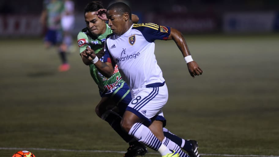 Henry Escobar (L) of Salvadorean team Santa Tecla F. C. fights for the ball with Joao Plata of US Real Salt Lake during a CONCACAF Champions League football match in Santa Tecla on September 15, 2015.   AFP PHOTO / Marvin RECINOS        (Photo credit should read Marvin RECINOS/AFP/Getty Images)