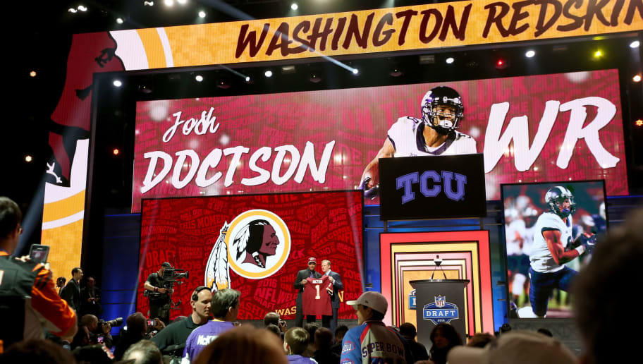 CHICAGO, IL - APRIL 28:  (L-R) Josh Doctson of TCU  holds up a jersey with NFL Commissioner Roger Goodell after being picked #22 overall by the Washington Redskins during the first round of the 2016 NFL Draft at the Auditorium Theatre of Roosevelt University on April 28, 2016 in Chicago, Illinois.  (Photo by Jonathan Daniel/Getty Images)