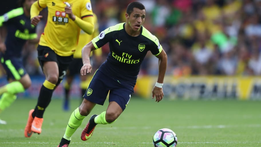 WATFORD, ENGLAND - AUGUST 27:  Alexis Sanchez of Arsenal runs with the ball during the Premier League match between Watford and Arsenal at Vicarage Road on August 27, 2016 in Watford, England.  (Photo by David Rogers/Getty Images)