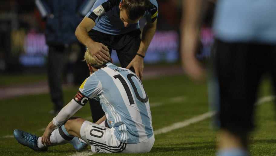 Uruguay's Gaston Silva pats the head of Argentina's Lionel Messi during the Russia 2018 World Cup qualifier football match in Mendoza, Argentina, on September 1, 2016. / AFP / ANDRES LARROVERE        (Photo credit should read ANDRES LARROVERE/AFP/Getty Images)