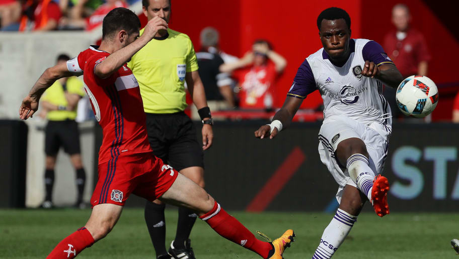 BRIDGEVIEW, IL - AUGUST 14: Cyle Larin #9 of Orlando City FC passes around Razvan Cocis #30 of Chicago Fire during an MLS match at Toyota Park on August 14, 2016 in Bridgeview, Illinois. The Fire and Orlando City SC tied 2-2. (Photo by Jonathan Daniel/Getty Images)