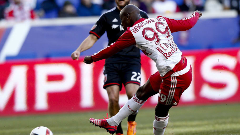 HARRISON, NJ - MARCH 22:  Bradley Wright-Phillips #99 of New York Red Bulls kicks a goal in front of Chris Korb #22 of D.C. United during their match at Red Bull Arena on March 22, 2015 in Harrison, New Jersey.  (Photo by Jeff Zelevansky/Getty Images)