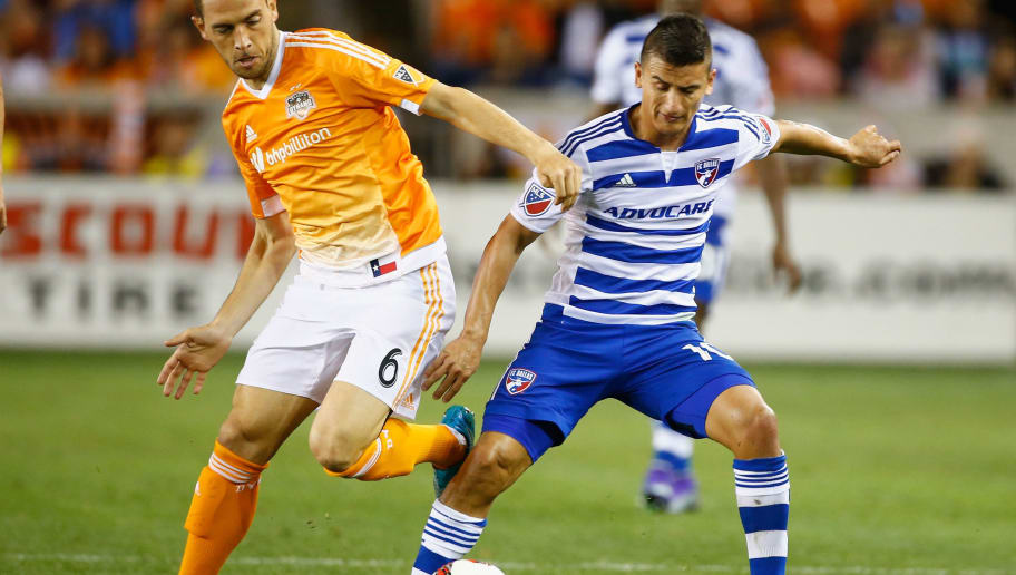 HOUSTON, TX - MARCH 12:  David Rocha #6 of the Houston Dynamo battles for the ball with Mauro Diaz #10 of FC Dallas during their game at BBVA Compass Stadium on March 12, 2016 in Houston, Texas.  (Photo by Scott Halleran/Getty Images)