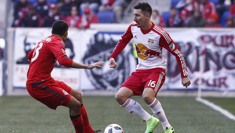 HARRISON, NJ - MARCH 6:  Sacha Kljestan #16 of New York Red Bulls dribbles past Steven Beitashour #33 of Toronto FC  during their match at Red Bull Arena on March 6, 2016 in Harrison, New Jersey.  (Photo by Jeff Zelevansky/Getty Images)