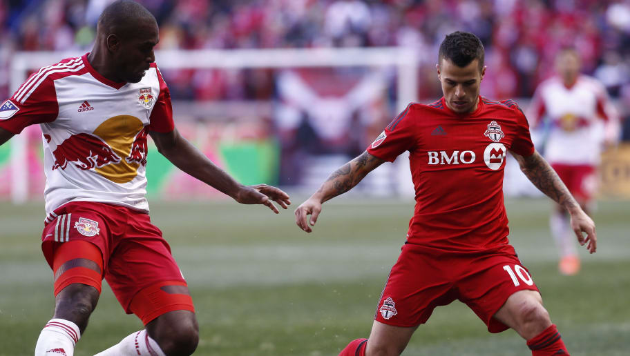 HARRISON, NJ - MARCH 6:  Sebastian Giovinco #10 of Toronto FC dribbles by Ronald Zubar #23 of New York Red Bulls during their match at Red Bull Arena on March 6, 2016 in Harrison, New Jersey.  (Photo by Jeff Zelevansky/Getty Images)