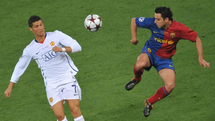 Barcelona's defender Xavi Hernandez (R) vies with Manchester's forward Cristiano Ronaldo during the UEFA football Champions League final match on May 27, 2009 at the Olympic Stadium in Rome. Barcelona defeated Manchester United 2-0 to win the Cup.    AFP PHOTO / MLADEN ANTONOV (Photo credit should read MLADEN ANTONOV/AFP/Getty Images)