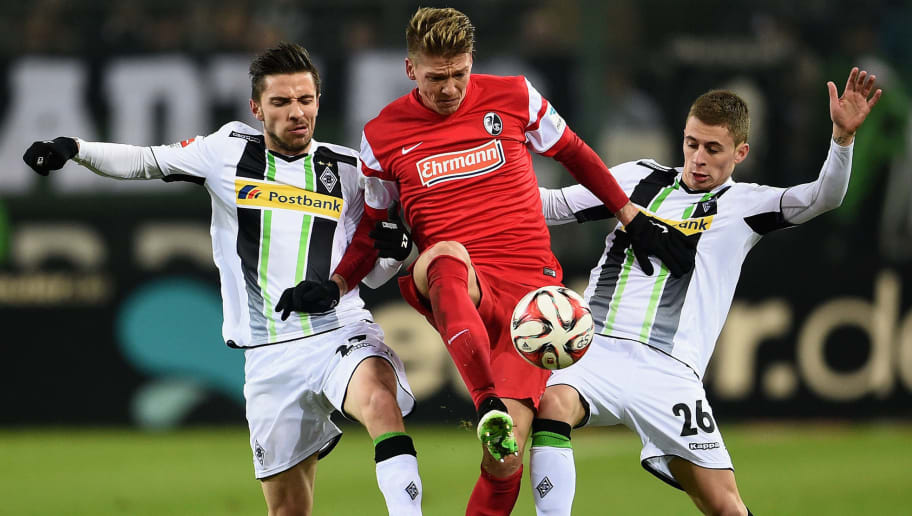 MOENCHENGLADBACH, GERMANY - FEBRUARY 03:  Julian Korb and Thorgan Hazard of Borussia Moenchengladbach challenge Mike Frantz of SC Freiburg during the Bundesliga match between Borussia Moenchengladbach and SC Freiburg at Borussia Park Stadium on February 3, 2015 in Moenchengladbach, Germany.  (Photo by Dennis Grombkowski/Bongarts/Getty Images)