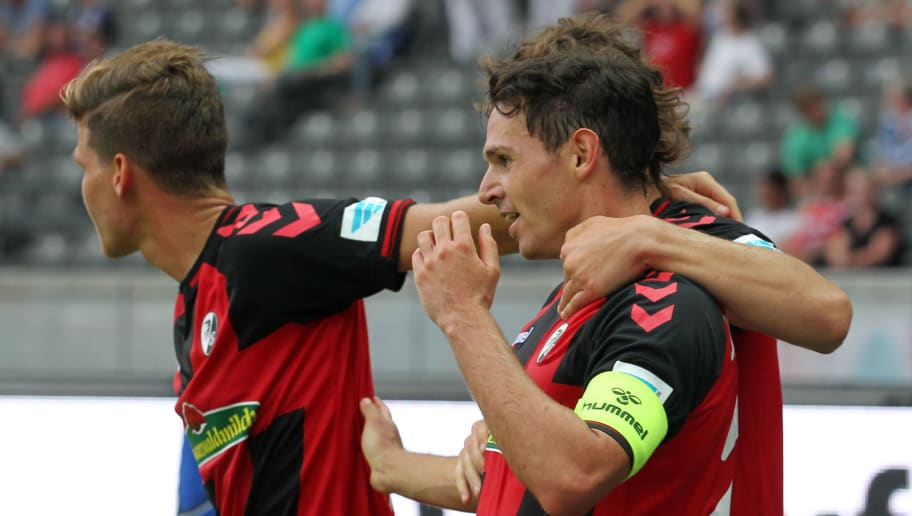 BERLIN, GERMANY - AUGUST 28:  Nicolas Hoefler (R) of Freiburg jubilates with team mates after scoring the second goal during the Bundesliga match between Hertha BSC and SC Freiburg at Olympiastadion on August 28, 2016 in Berlin, Germany.  (Photo by Matthias Kern/Bongarts/Getty Images)