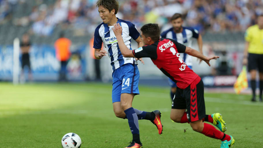 BERLIN, GERMANY - AUGUST 28:  Genki Haraguchi (L) of Berlin battles for the ball with Aleksandar Ignjovski (R) of Freiburg during the Bundesliga match between Hertha BSC and SC Freiburg at Olympiastadion on August 28, 2016 in Berlin, Germany. (Photo by Matthias Kern/Bongarts/Getty Images)