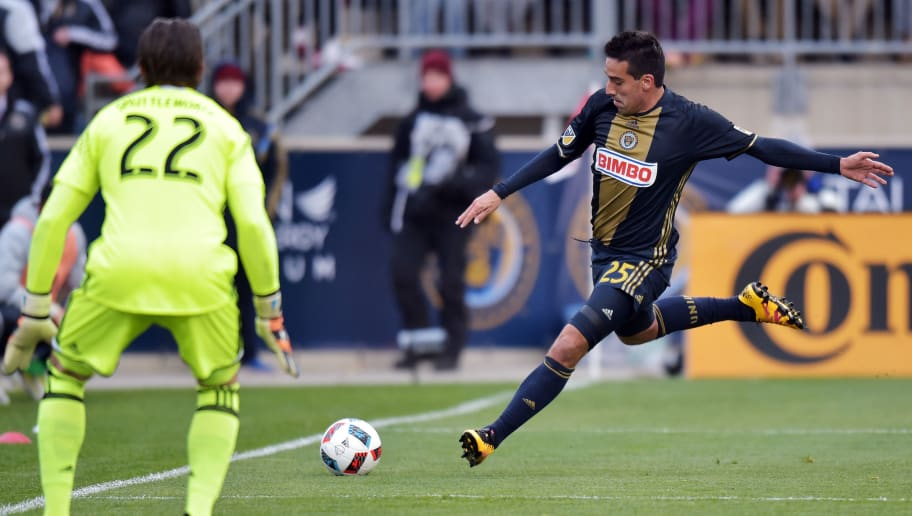 CHESTER, PA - MARCH 20: Ilsinho #25 of Philadelphia Union takes a shot on Bobby Shuttleworth #22 of New England Revolution at Talen Energy Stadium on March 20, 2016 in Chester, Pennsylvania. The Union won 3-0.  (Photo by Drew Hallowell/Getty Images)
