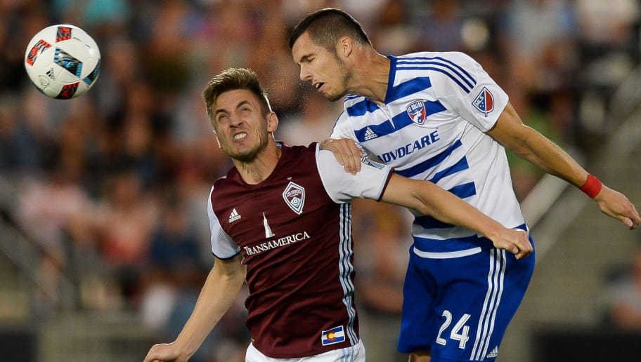 COMMERCE CITY, CO - JULY 23: Kevin Doyle #9 of Colorado Rapids and Matt Hedges #24 of FC Dallas jump to control the ball during a game at Dick's Sporting Goods Park on July 23, 2016 in Commerce City, Colorado. (Photo by Dustin Bradford/Getty Images)