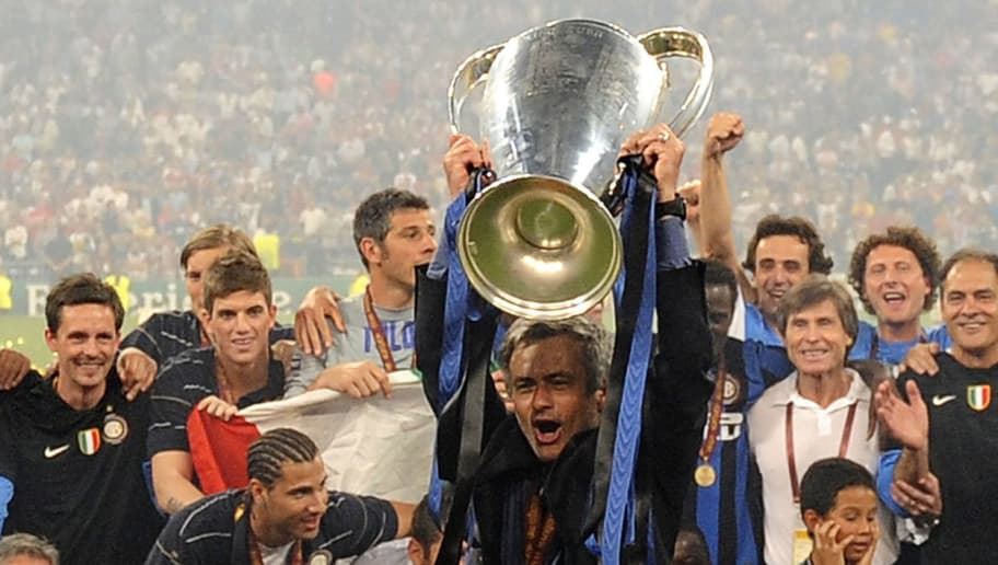 Inter Milan's coach Jose Mourinho holds up the trophy after winning the UEFA Champions League final football match against Bayern Munich at the Santiago Bernabeu stadium in Madrid on May 22, 2010. Inter Milan won the Champions League with a 2-0 victory over Bayern Munich in the final at the Santiago Bernabeu. Argentine striker Diego Milito scored both goals for Jose Mourinho's team who completed a treble of trophies this season. AFP PHOTO / PEDRO ARMESTRE  (Photo credit should read PEDRO ARMESTRE/AFP/Getty Images)