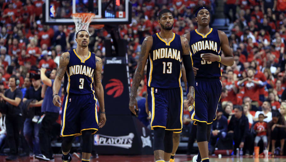 TORONTO, ON - MAY 01:  George Hill #3, Paul George #13 and Myles Turner #33 of the Indiana Pacers walk to the bench during a break in the first half of Game Seven of the Eastern Conference Quarterfinals against the Toronto Raptors during the 2016 NBA Playoffs at the Air Canada Centre on May 01, 2016 in Toronto, Ontario, Canada.  NOTE TO USER: User expressly acknowledges and agrees that, by downloading and or using this photograph, User is consenting to the terms and conditions of the Getty Images License Agreement.  (Photo by Vaughn Ridley/Getty Images)
