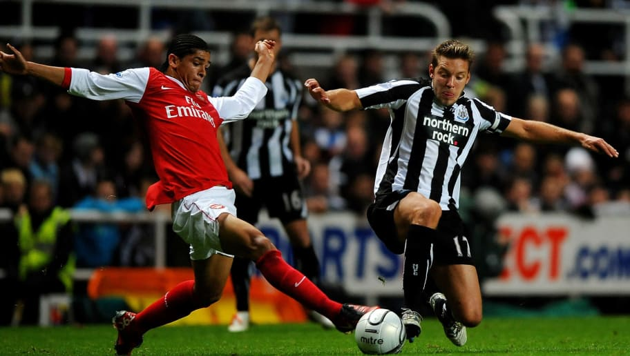 NEWCASTLE UPON TYNE, ENGLAND - OCTOBER 27:  Alan Smith of Newcastle United is challenged by Denilson of Arsenal during the Carling Cup Fourth Round match between Newcastle United and Arsenal at St James' Park on October 27, 2010 in Newcastle, England.  (Photo by Laurence Griffiths/Getty Images)
