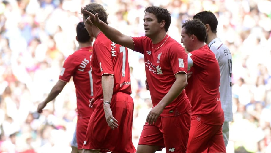 Liverpool's forward Michael Owen (C) celebrates after scoring during the 'El Corazon Classic' charity football match Real Madrid Legends vs Liverpool Legends at the Santiago Bernabeu stadium in Madrid on June 14, 2015.  AFP PHOTO / PIERRE-PHILIPPE MARCOU        (Photo credit should read PIERRE-PHILIPPE MARCOU/AFP/Getty Images)