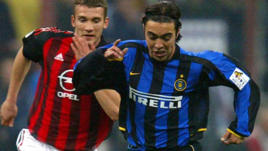 MILAN - APRIL 11:  Alvaro Recoba of Inter Milan and Andriy Shevchenko of AC Milan in action during the Serie A match between Inter Milan and AC Milan, played at the 'Giuseppe Meazza' San Siro Stadium, Milan, Italy on April 11, 2003.  (Photo by Grazia Neri/Getty Images)
