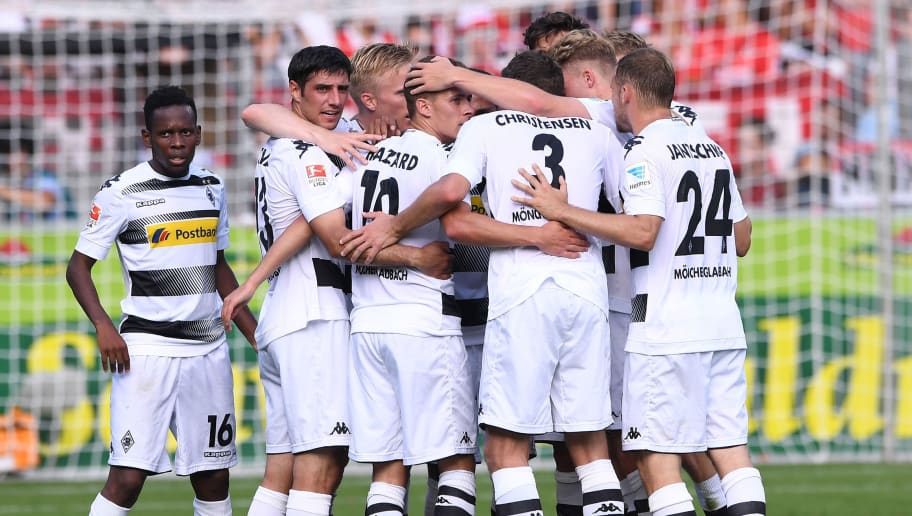 FREIBURG GERMANY - SEPTEMBER 10: Players of Borussia Moenchengladbach celebrating opening goal of Thorgan Hazard (nb 10) during the Bundesliga match between Sport Club Freiburg and Borussia Moenchengladbach at Schwarzwald-Stadion on September 10, 2016 in Freiburg, Germany.  (Photo by Michael Kienzler/Bongarts/Getty Images)